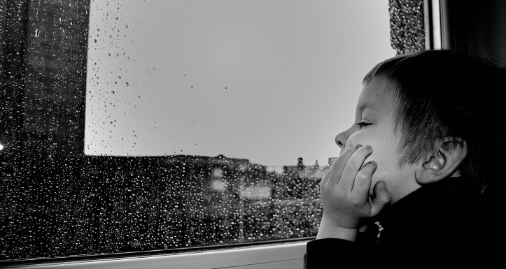 Canva - Child Watching the Rain by the Window